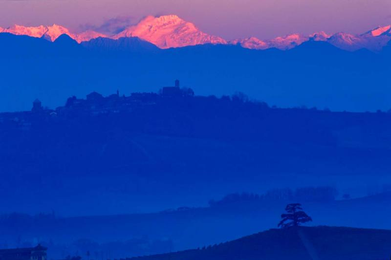 Beautiful view of Monte Rosa before dawn and the blue hills of Langa, Piedmont, Italy.